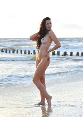 beach breast: Young fully nude woman posing on the beach