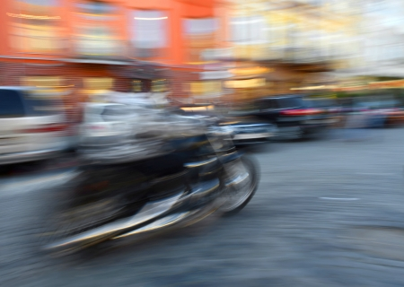 Motorcyclist in motion going down the street   Intentional motion blur photo