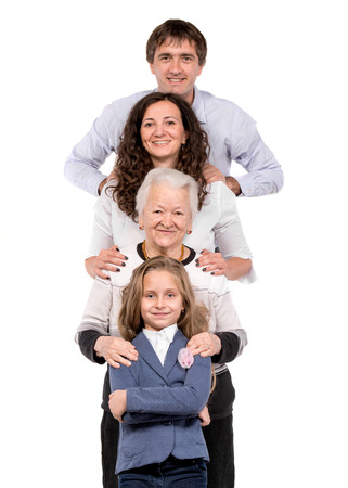 Row of family looking at camera in line on a white background Standard-Bild