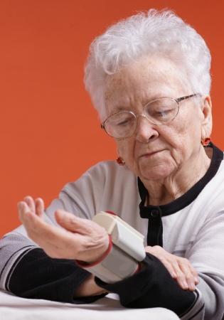 arterial: Old woman measures arterial pressure