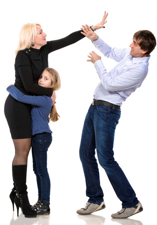 Sad looking girl with her fighting parents on a white background photo