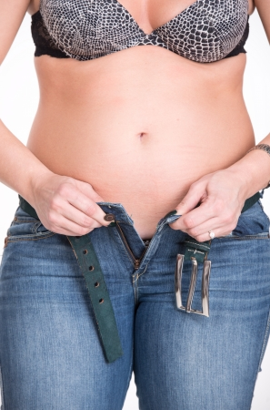 Plump woman trying to wear jeans photo