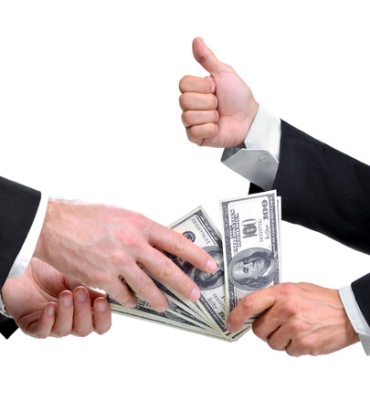 Hands of two businessmen giving and taking dollars photo