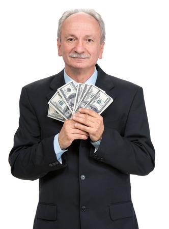 Senior businessman holding group of dollar bills on a white background 免版税图像