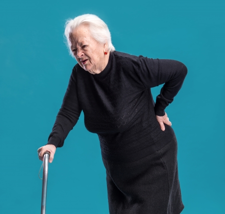 Old woman holding her lower back  Low back pain photo