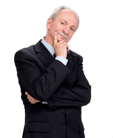 Senior businessman posing on a white background photo