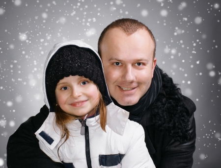 outwear: Smiling father and daughter in winter outwear