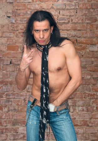 Handsome man with long hair and naked torso  photo