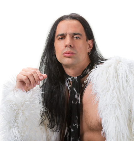 Young man with long hair in fur coat  photo