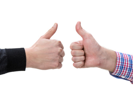 Two male hands showing thumbs up sign on a  white background