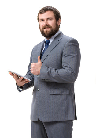Businessman with tablet pc on a white Stock Photo - 25025021