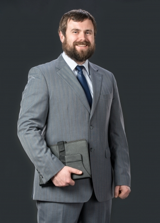 Businessman holding tablet pc  Stock Photo - 25025415