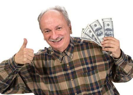 fortunate: Happy senior man holding dollar bills