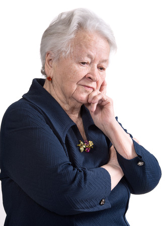 Portrait of pensive old woman on white  photo