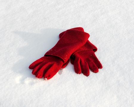 knitten: Red gloves on snow