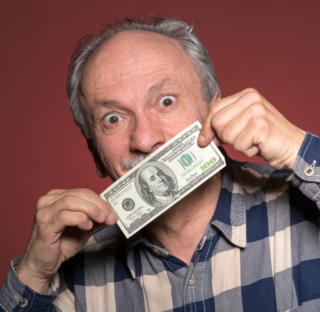 fortunate: Elderly man holding with pleasure one hundred dollar bill