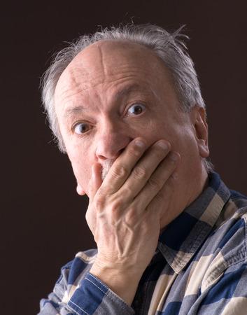 Portrait of a very surprised elderly men  photo