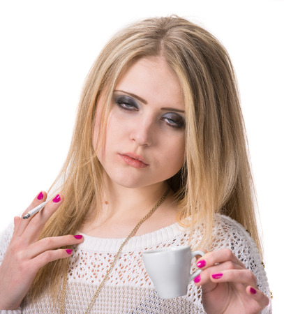 Smoking teen girl  holding cup of coffee