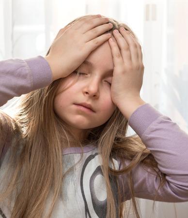 Little girl suffering from headache