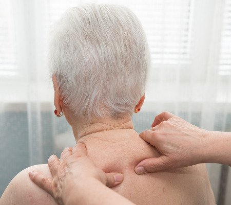 Old woman having a massage photo