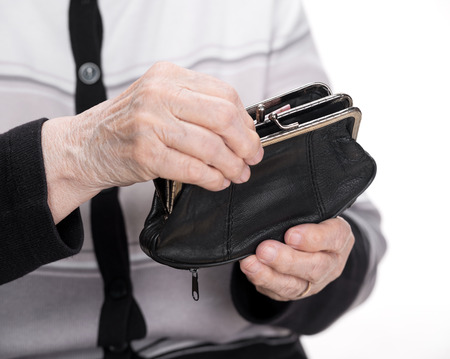 moneyless: Purse in the hands of an old woman
