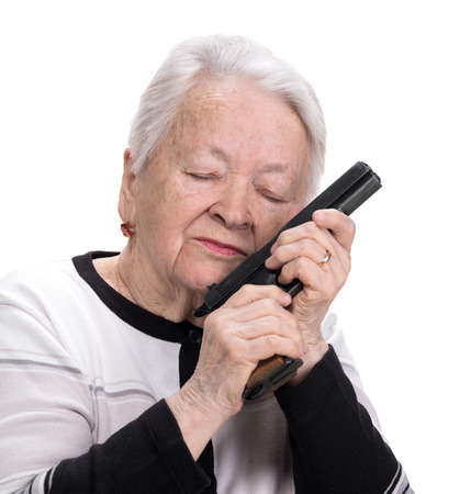Old woman with pistol on a white background