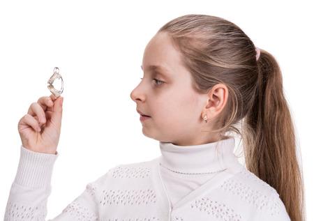 Girl holding dental braces over white photo