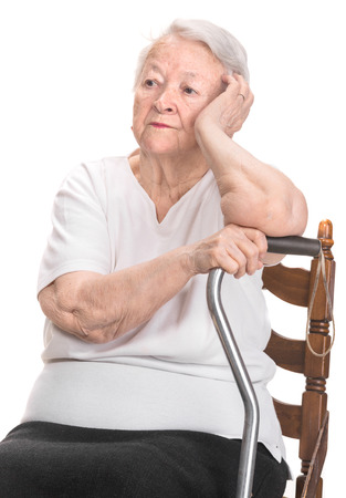 Thoughtful old woman on a white background photo