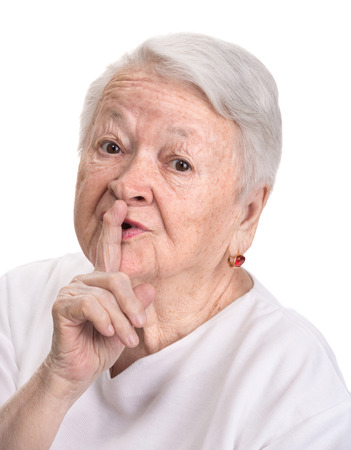 Old woman with finger on lips asking for silence on a white background Stock Photo - 27226852