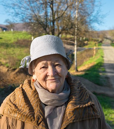 Portrait of old woman  in spring park