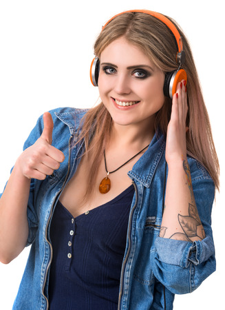 Smiling young girl in headphones on a white  photo
