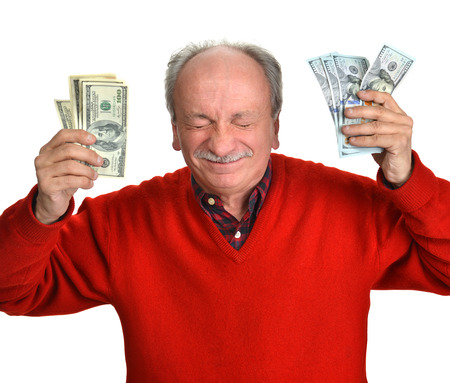 Lucky old man holding dollar bills on a white background photo