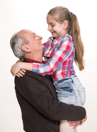 Grandfather with granddaughter on a white background photo