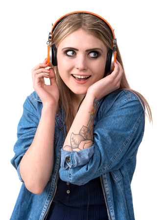 Smiling young girl in headphones on a white background photo