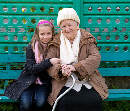 Grandmother and grandchild sitting on the bench