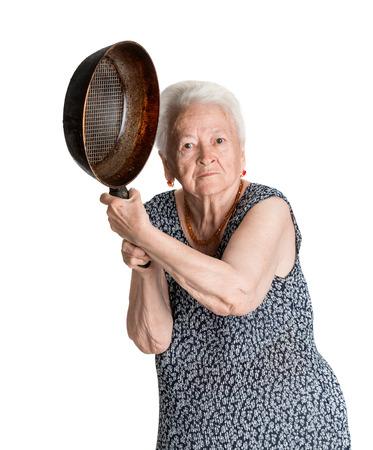 白い背景の上の鍋で怒っている歳の女性 写真素材