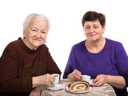 Mother having coffee with her daughter on a white background photo