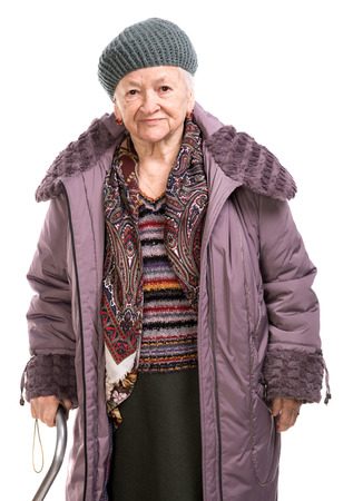 fine cane: Old woman with a cane in outwear over white background Stock Photo