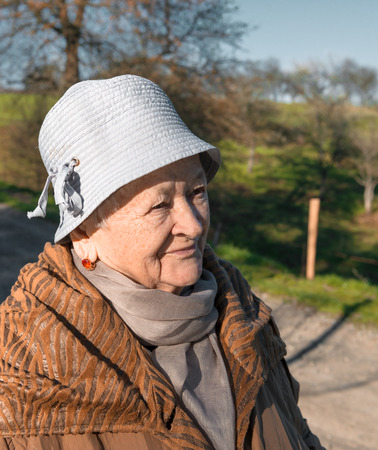 eighty: Portrait of old woman in spring park Stock Photo