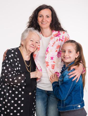 three generations of women: Three generations of women on a white