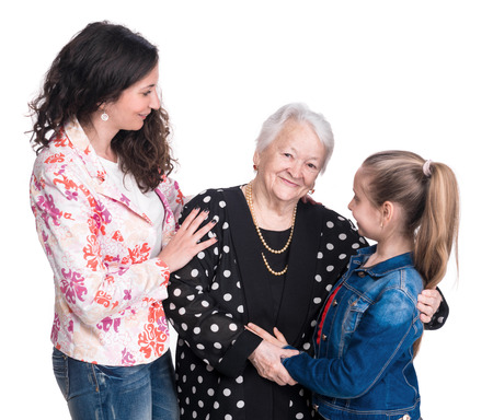 respecting: Three generations of women on a white