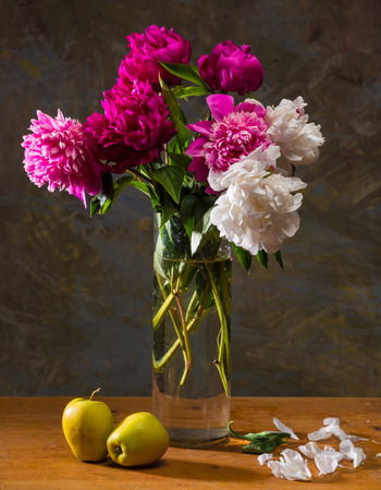 Artistic still life with peonies and apples photo