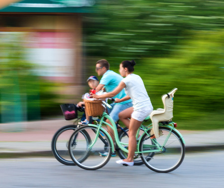 Cyclists on the city roadway in motion blur 免版税图像
