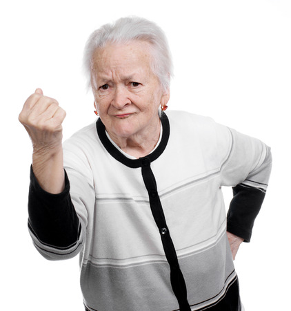 Angry old woman making fists on a white background