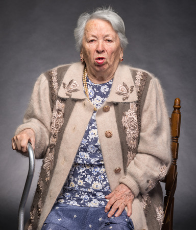 Portrait of old coughing woman photo