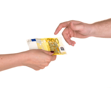 lend a hand: Woman giving 200 euro banknote to a man, isolated on white Stock Photo