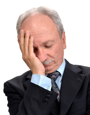 Senior businessman having headache, isolated on white photo