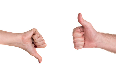 Thumbs up and down showing disagreement on a white background Stock Photo