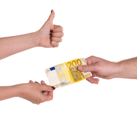 Woman giving 200 euro banknote to a man, isolated on white photo