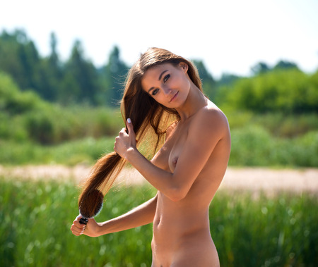 adult nude: Beautiful nude woman with comb on nature background Stock Photo